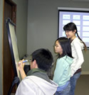 teen students working on a class activity together